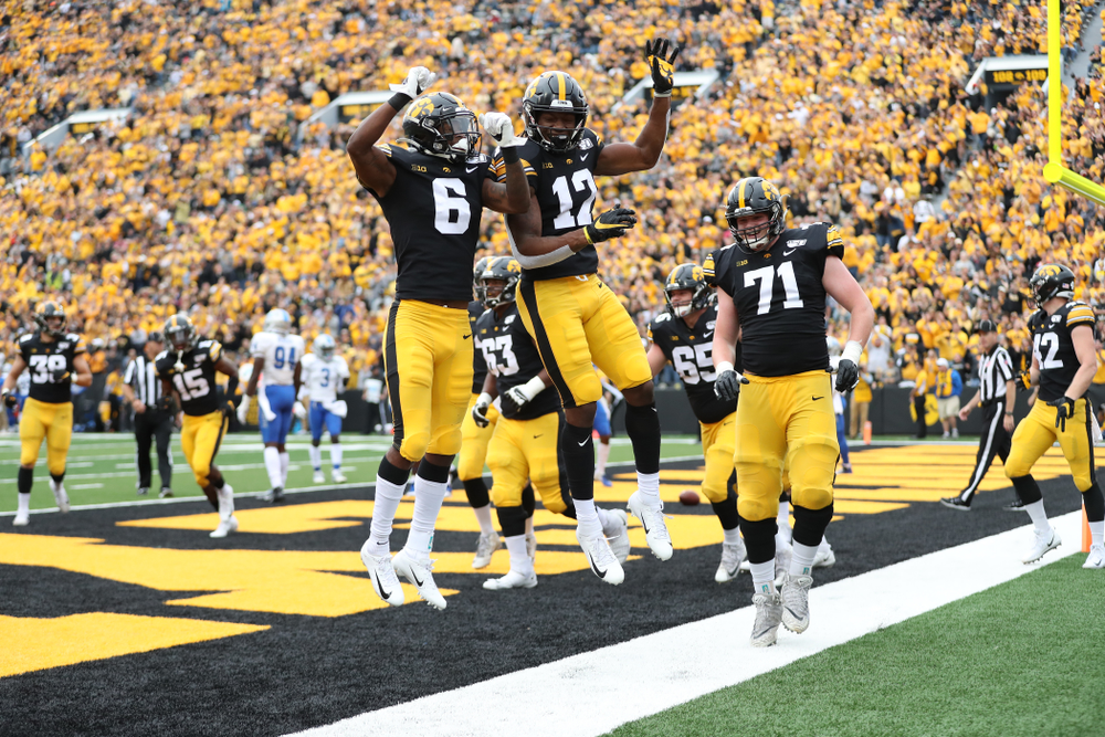 Iowa Hawkeyes wide receiver Brandon Smith (12) celebrates with wide receiver Ihmir Smith-Marsette (6) against Middle Tennessee State Saturday, September 28, 2019 at Kinnick Stadium. (Max Allen/hawkeyesports.com)