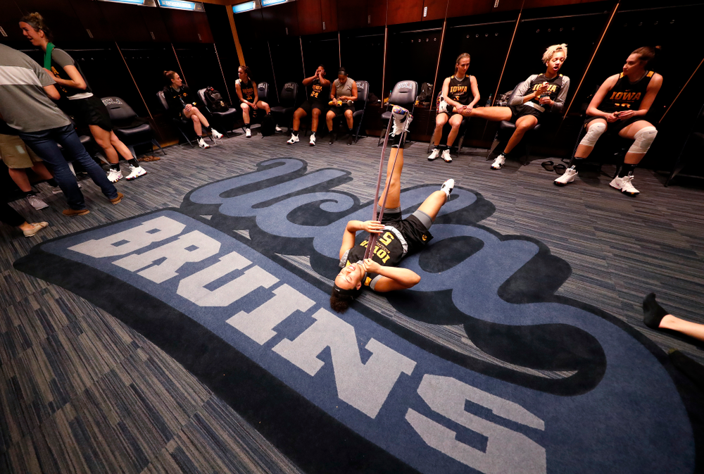 Iowa Hawkeyes guard Alexis Sevillian (5) stretches before practice Friday, March 16, 2018 at Pauley Pavilion on the campus of UCLA. (Brian Ray/hawkeyesports.com)