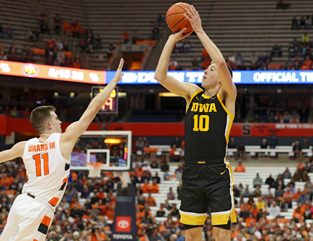 Iowa Hawkeyes guard Joe Wieskamp (10) puts up a shot during the first half of their ACC/Big Ten Challenge game at the Carrier Dome in Syracuse, N.Y. on Tuesday, Dec 3, 2019. (Stephen Mally/hawkeyesports.com)