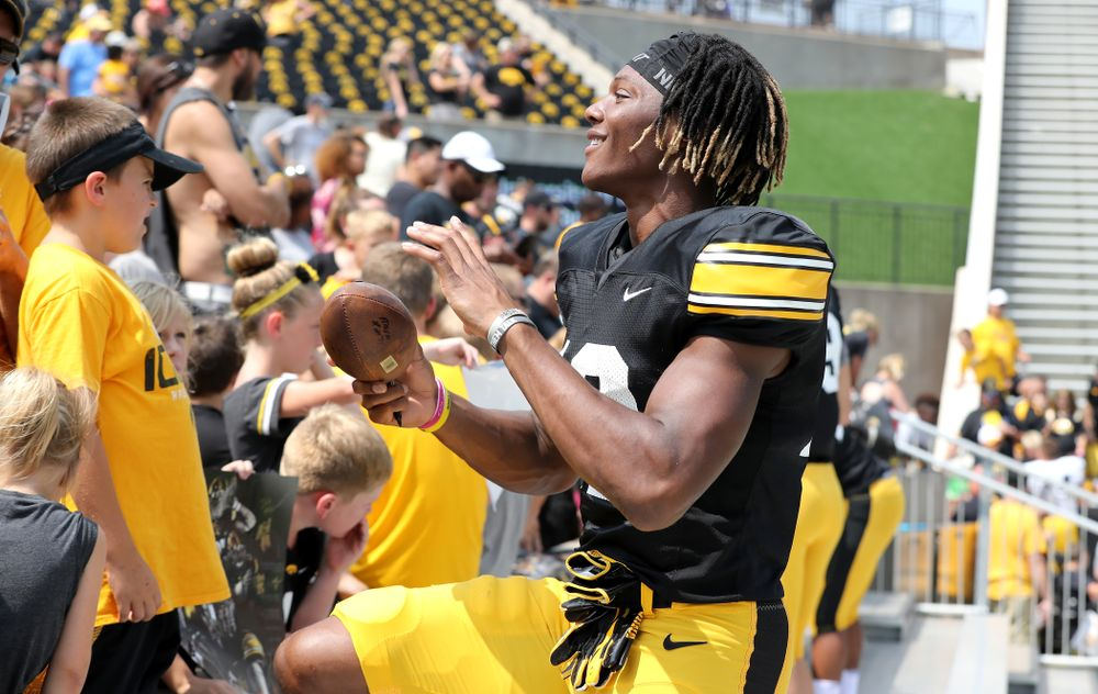 Iowa Hawkeyes wide receiver Brandon Smith (12) during Kids Day Saturday, August 11, 2018 at Kinnick Stadium. (Brian Ray/hawkeyesports.com)