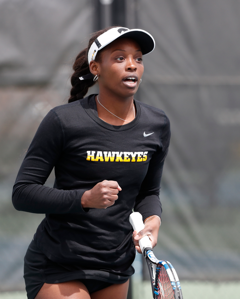 Adorabol Huckleby and Zoe Douglas play a doubles match against the Wisconsin Badgers Sunday, April 22, 2018 at the Hawkeye Tennis and Recreation Center. (Brian Ray/hawkeyesports.com)