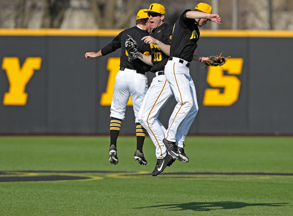 Iowa Hawkeyes center fielder Justin Jenkins (6), right fielder Connor McCaffery (30), and left fielder Ben Norman (9) celebrate after winning their game against Rutgers at Duane Banks Field in Iowa City on Saturday, Apr. 6, 2019. (Stephen Mally/hawkeyesports.com)