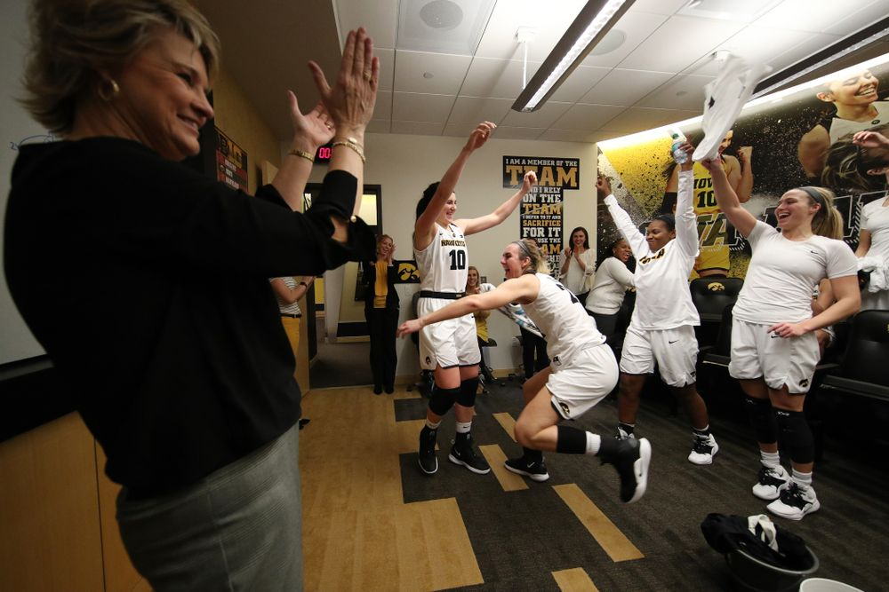 Iowa Hawkeyes forward Megan Gustafson (10) and forward Hannah Stewart (21) celebrate their victory over the Rutgers Scarlet Knights Wednesday, January 23, 2019 at Carver-Hawkeye Arena. (Brian Ray/hawkeyesports.com)