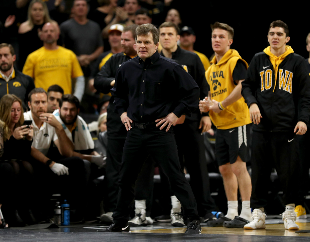 Associate Head Coach Terry Brands works the edge of the mat as Iowa's Michael Kemerer wrestles Ohio State's Kaleb Romero at 174 pounds Friday, January 24, 2020 at Carver-Hawkeye Arena. Kemerer won the match 7-1. (Brian Ray/hawkeyesports.com)