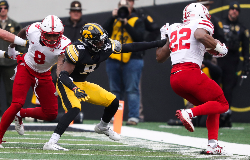 Iowa Hawkeyes defensive back Matt Hankins (8) pushes the ballcarrier out of bounds during a game against Nebraska at Kinnick Stadium on November 23, 2018. (Tork Mason/hawkeyesports.com)