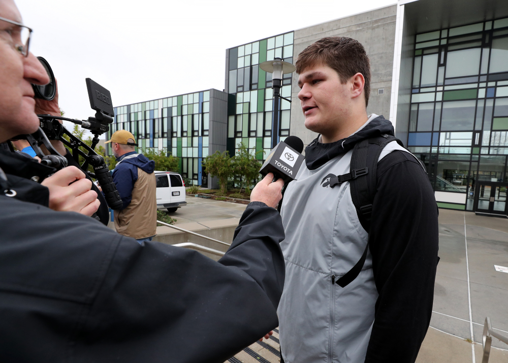 Iowa Hawkeyes offensive lineman Tyler Linderbaum (65) answers questions from the media following practice Monday, December 23, 2019 at Mesa College in San Diego. (Brian Ray/hawkeyesports.com)