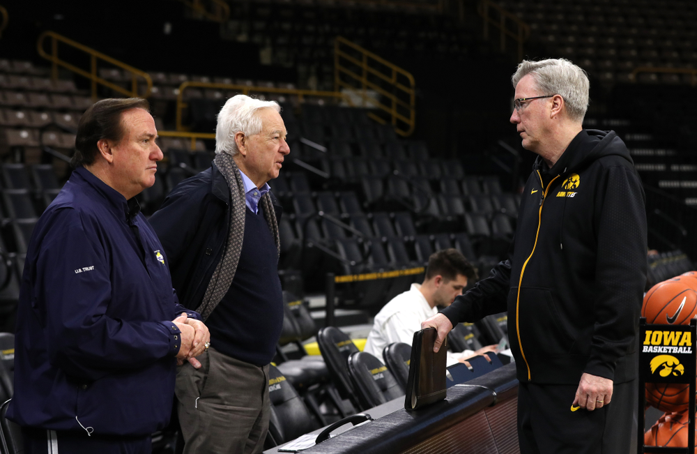 Iowa Hawkeyes head coach Fran McCaffery and assistant coach Kirk Speraw talk with television announcers Tim Brando and Bill Rafferty before their game against the Michigan State Spartans Thursday, January 24, 2019 at Carver-Hawkeye Arena. (Brian Ray/hawkeyesports.com)