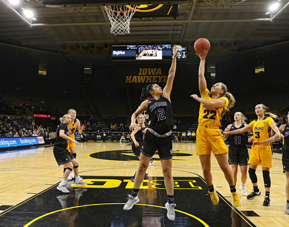Iowa guard Kathleen Doyle (22) puts up a shot during the first quarter of their game against Winona State at Carver-Hawkeye Arena in Iowa City on Sunday, Nov 3, 2019. (Stephen Mally/hawkeyesports.com)
