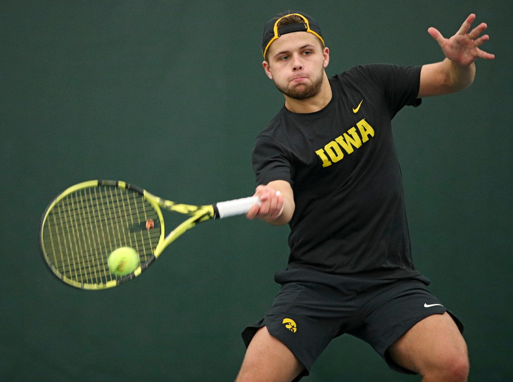 Iowa's Will Davies hits a shot during his match against Marquette at the Hawkeye Tennis and Recreation Complex in Iowa City on Saturday, January 25, 2020. (Stephen Mally/hawkeyesports.com)