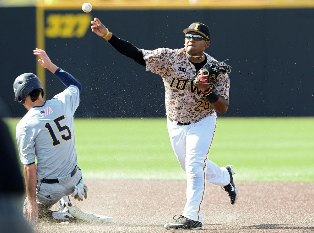 Iowa Hawkeyes second baseman Izaya Fullard (20) throws to first base as they turn a double play during the eighth inning of their game against UC Irvine at Duane Banks Field in Iowa City on Sunday, May. 5, 2019. (Stephen Mally/hawkeyesports.com)
