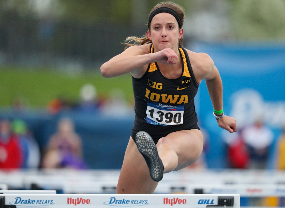 Iowa's Carly Donahue runs the women's shuttle hurdles event during the third day of the Drake Relays at Drake Stadium in Des Moines on Saturday, Apr. 27, 2019. (Stephen Mally/hawkeyesports.com)