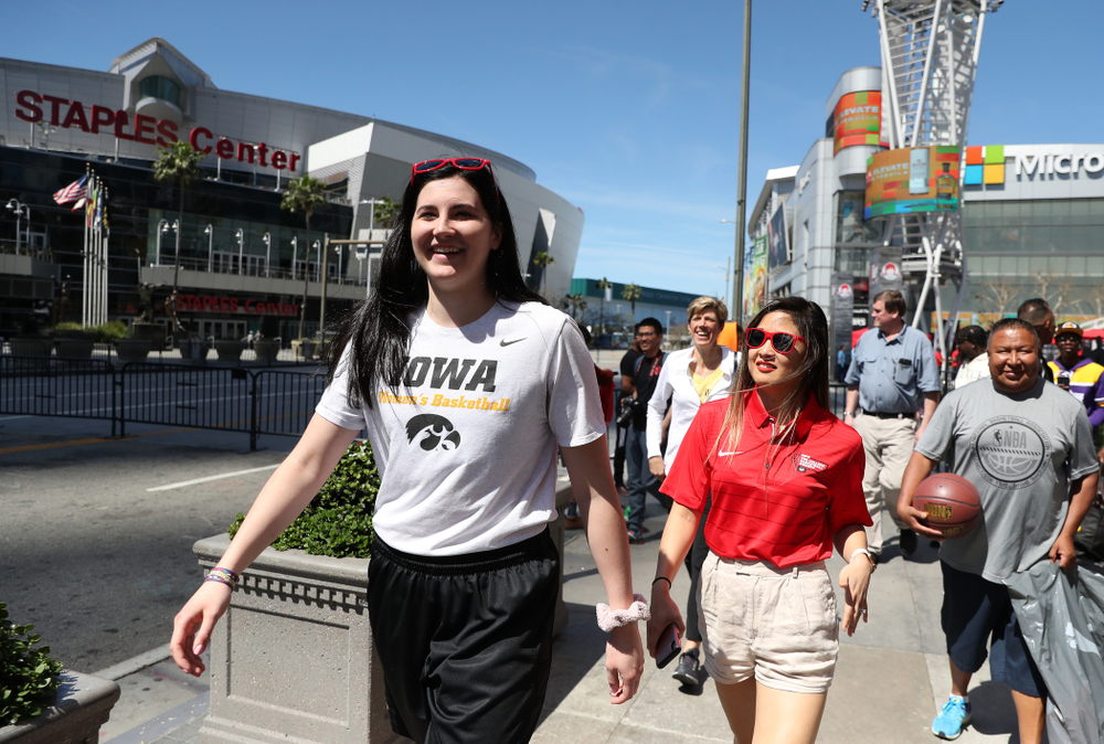 Iowa Hawkeyes forward Megan Gustafson (10) walks past the Staples Center following  a Special Olympics event Friday, April 12, 2019 as part of the ESPN College Basketball Awards in the XBOX Plaza at LA Live.  (Brian Ray/hawkeyesports.com)
