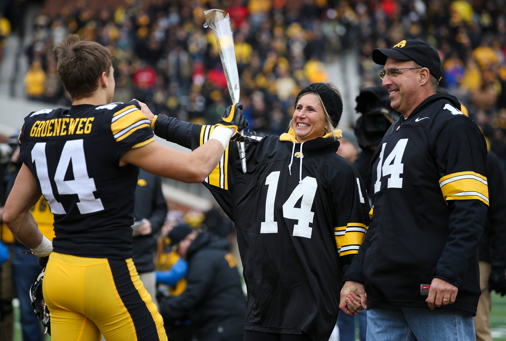 Iowa Hawkeyes wide receiver Kyle Groeneweg (14) is greeted by his parents during Senior Day ceremonies before a game against Nebraska at Kinnick Stadium on November 23, 2018. (Tork Mason/hawkeyesports.com)