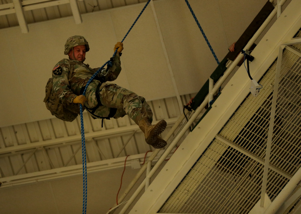 Members of the Iowa Army and Air Force ROTC rappel down from the rafters before the Iowa Hawkeyes game against Penn State Saturday, February 29, 2020 at Carver-Hawkeye Arena. (Brian Ray/hawkeyesports.com)