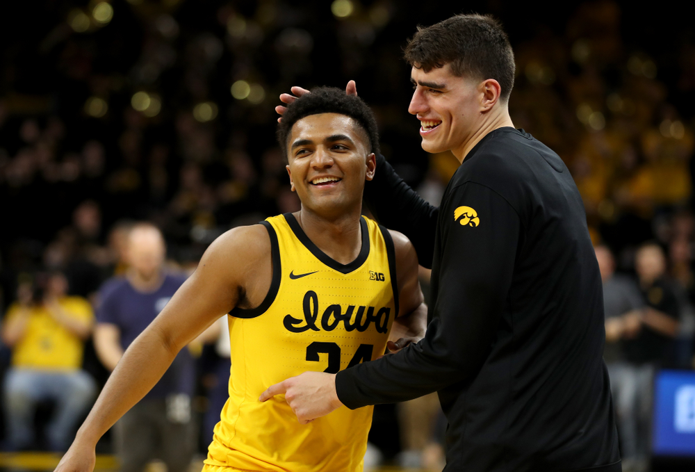 Iowa Hawkeyes guard Nicolas Hobbs (24) celebrates with forward Luka Garza (55) following their win against the Nebraska Cornhuskers Saturday, February 8, 2020 at Carver-Hawkeye Arena. (Brian Ray/hawkeyesports.com)