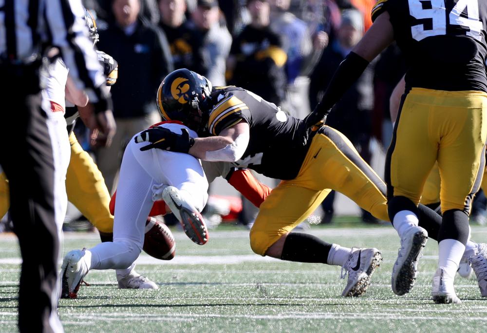 Iowa Hawkeyes linebacker Kristian Welch (34) causes a fumble against the Illinois Fighting Illini Saturday, November 23, 2019 at Kinnick Stadium. (Brian Ray/hawkeyesports.com)