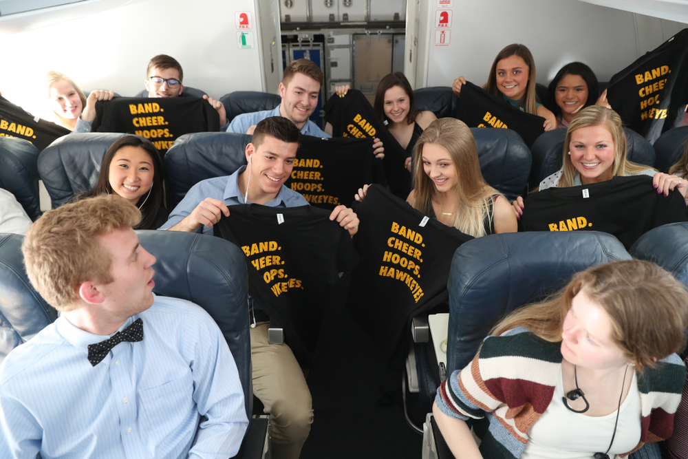 The Iowa Women's Basketball team handed out t-shirts to the band and spirit squad on board the team plane to Greensboro, NC for the Regionals of the 2019 NCAA Women's Basketball Championships Thursday, March 28, 2019 at the Eastern Iowa Airport. (Brian Ray/hawkeyesports.com)