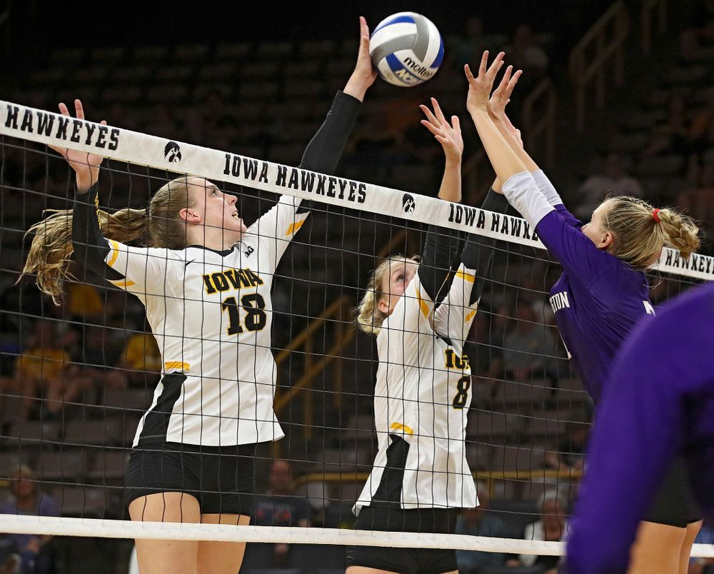 Iowa's Hannah Clayton (18) gets her hand on a shot as Kyndra Hansen (8) looks on during their Big Ten/Pac-12 Challenge match at Carver-Hawkeye Arena in Iowa City on Saturday, Sep 7, 2019. (Stephen Mally/hawkeyesports.com)