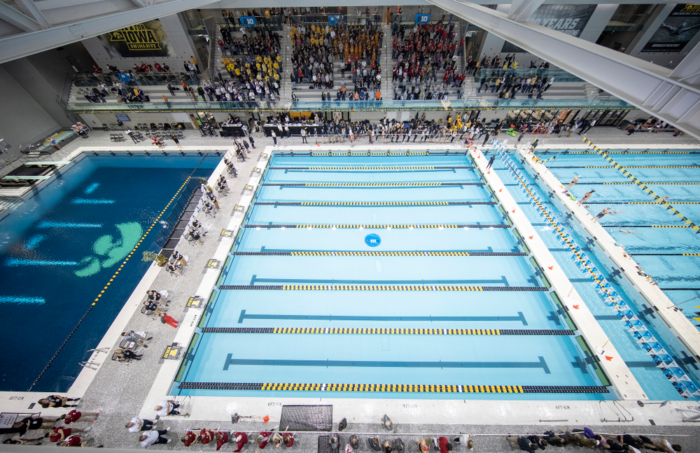 People stand for the National Anthem during the 2020 Women's Big Ten Swimming and Diving Championships at the Campus Recreation and Wellness Center in Iowa City on Thursday, February 20, 2020. (Stephen Mally/hawkeyesports.com)