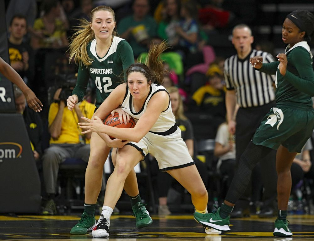 Iowa Hawkeyes guard Mckenna Warnock (14) is fouled after grabbing a rebound during the fourth quarter of their game at Carver-Hawkeye Arena in Iowa City on Sunday, January 26, 2020. (Stephen Mally/hawkeyesports.com)