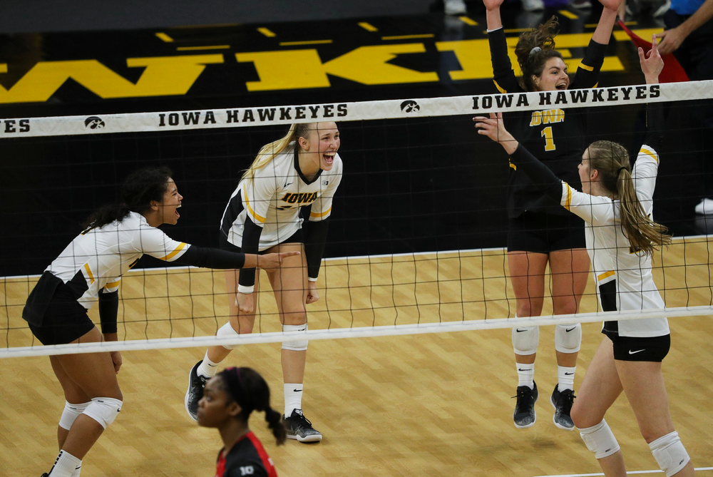 Iowa Hawkeyes setter Brie Orr (7), Iowa Hawkeyes outside hitter Cali Hoye (14) and Iowa Hawkeyes defensive specialist Molly Kelly (1) celebrate after winning a point during a match against Rutgers at Carver-Hawkeye Arena on November 2, 2018. (Tork Mason/hawkeyesports.com)