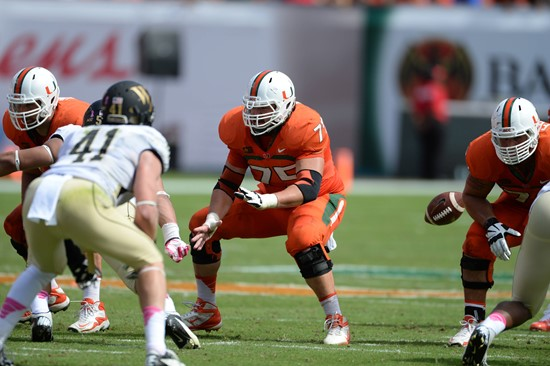University of Miami Hurricanes offensive lineman Jared Wheeler #75 gets set to block against the Wake Forest Demon Deacons at Sun Life Stadium on...