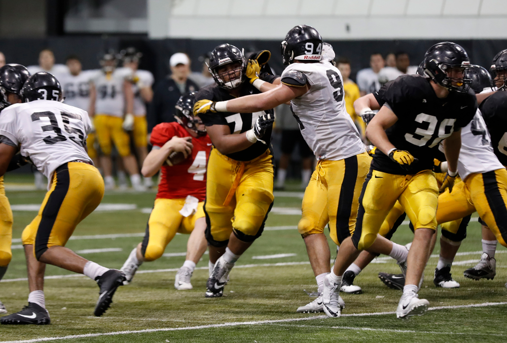 Iowa Hawkeyes offensive lineman Tristan Wirfs (74) and defensive end A.J. Epenesa (94) during spring practice No. 13 Wednesday, April 18, 2018 at the Hansen Football Performance Center. (Brian Ray/hawkeyesports.com)
