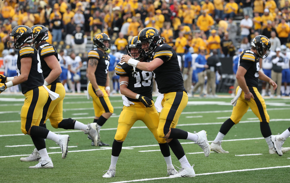 Iowa Hawkeyes quarterback Spencer Petras (7) hugs wide receiver Max Cooper (19) after scoring gainst Middle Tennessee State Saturday, September 28, 2019 at Kinnick Stadium. (Brian Ray/hawkeyesports.com)