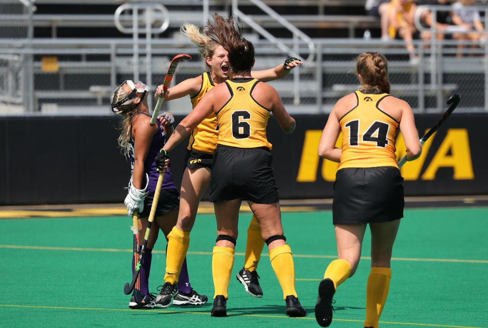Iowa Hawkeyes defenseman Anthe Nijziel (6) and Ellie Holley (7) celebrate after scoring on a penalty corner during an exhibition game against Northwestern Saturday, August 24, 2019 at Grant Field. (Brian Ray/hawkeyesports.com)