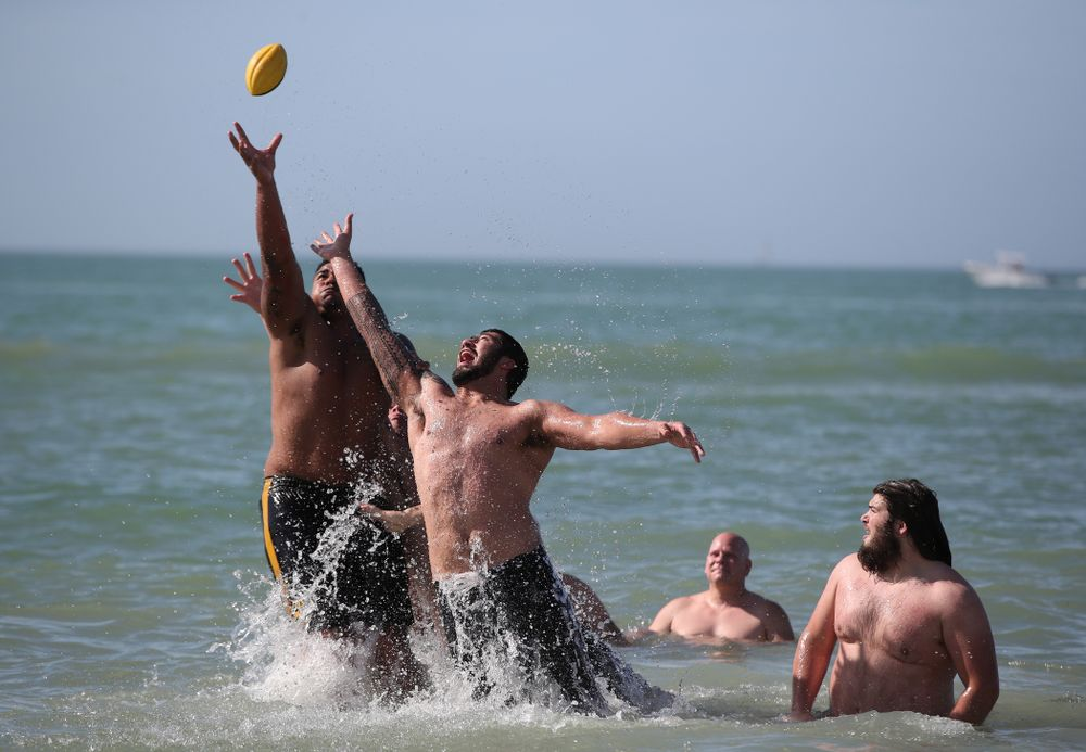 Iowa Hawkeyes offensive lineman Tristan Wirfs (74) and defensive end A.J. Epenesa (94) during the Outback Bowl Beach Day Sunday, December 30, 2018 at Clearwater Beach. (Brian Ray/hawkeyesports.com)