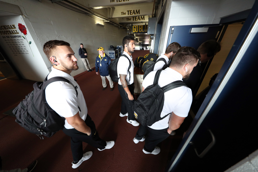 Iowa Hawkeyes defensive end A.J. Epenesa (94) and tight end Nate Wieting (39) arrive for their game against the Michigan Wolverines Saturday, October 5, 2019 at Michigan Stadium in Ann Arbor, MI. (Brian Ray/hawkeyesports.com)