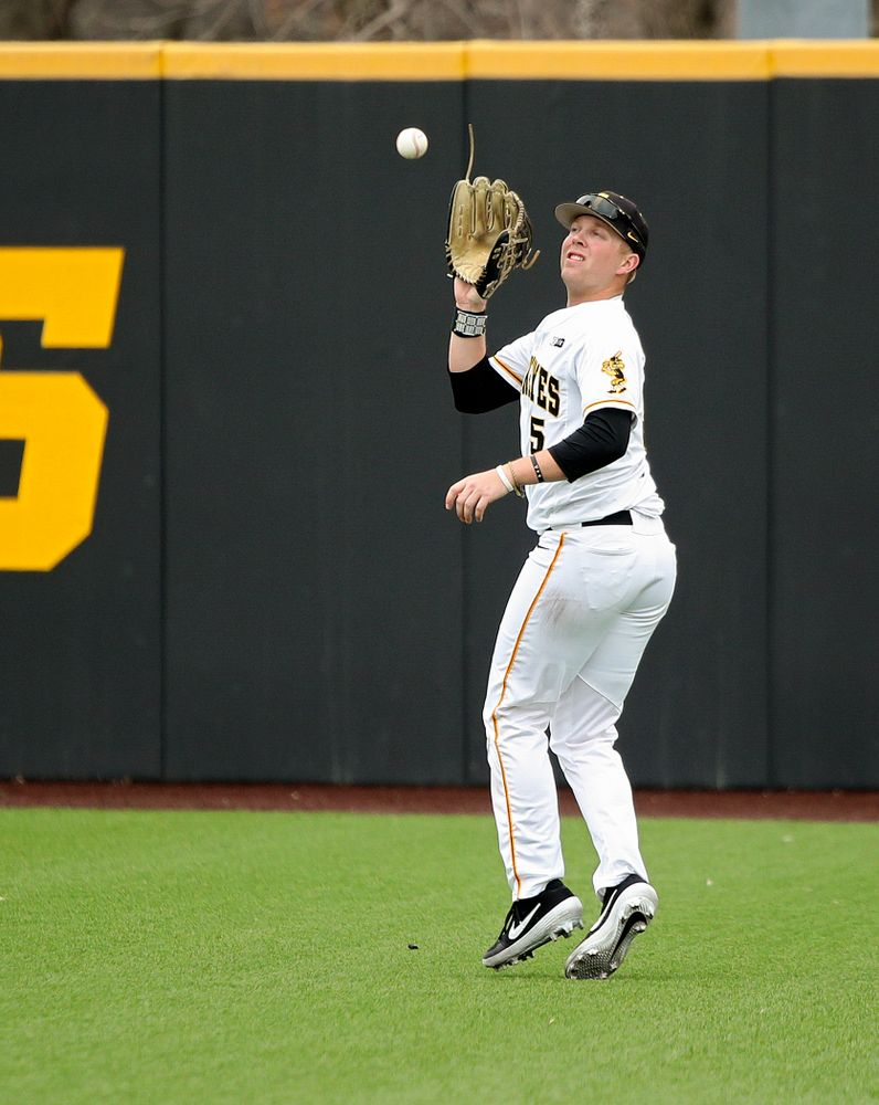 Iowa right fielder Zeb Adreon (5) runs down a fly ball for an out during the third inning of their college baseball game at Duane Banks Field in Iowa City on Wednesday, March 11, 2020. (Stephen Mally/hawkeyesports.com)
