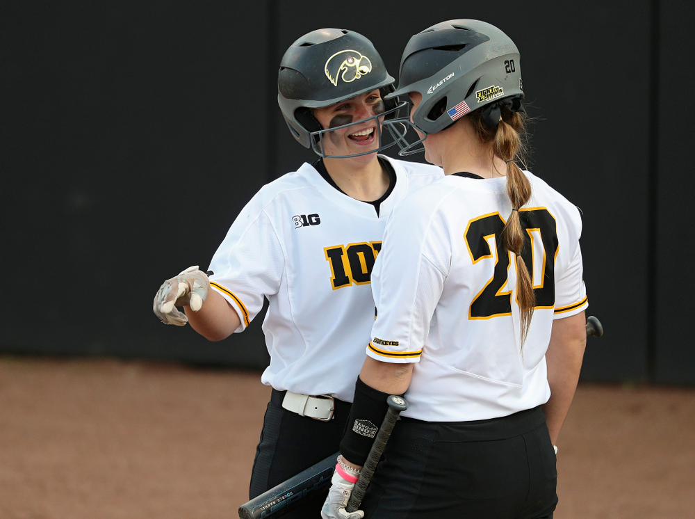 Iowa catcher Abby Lien (9) talks with designated player Miranda Schulte (20) before Schulte's at-bat during the sixth inning of their game against Ohio State at Pearl Field in Iowa City on Friday, May. 3, 2019. (Stephen Mally/hawkeyesports.com)