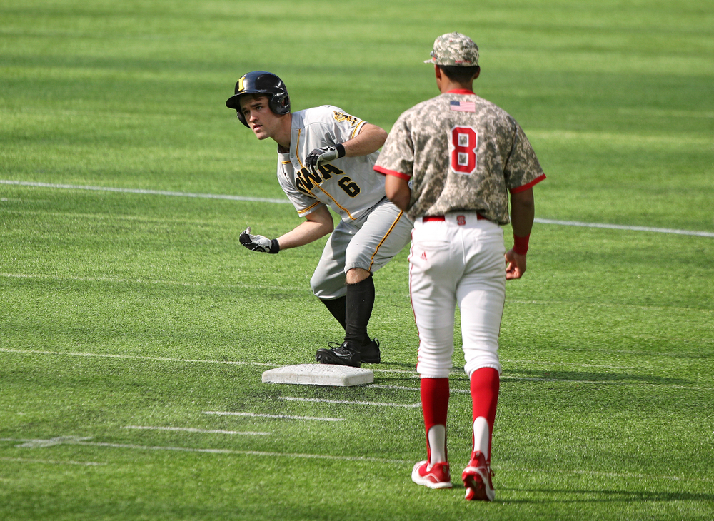 Iowa Hawkeyes outfielder Justin Jenkins (6) celebrates after hitting an RBI double during the seventh inning of their CambriaCollegeClassic game at U.S. Bank Stadium in Minneapolis, Minn. on Friday, February 28, 2020. (Stephen Mally/hawkeyesports.com)
