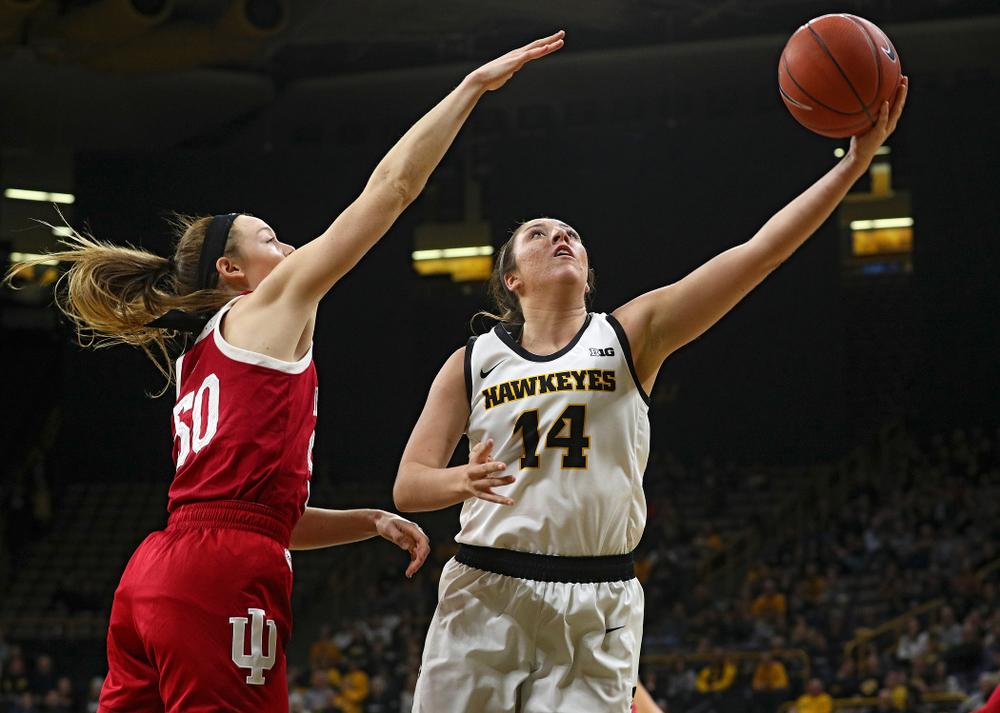 Iowa Hawkeyes guard Mckenna Warnock (14) makes a basket during the second quarter of their game at Carver-Hawkeye Arena in Iowa City on Sunday, January 12, 2020. (Stephen Mally/hawkeyesports.com)