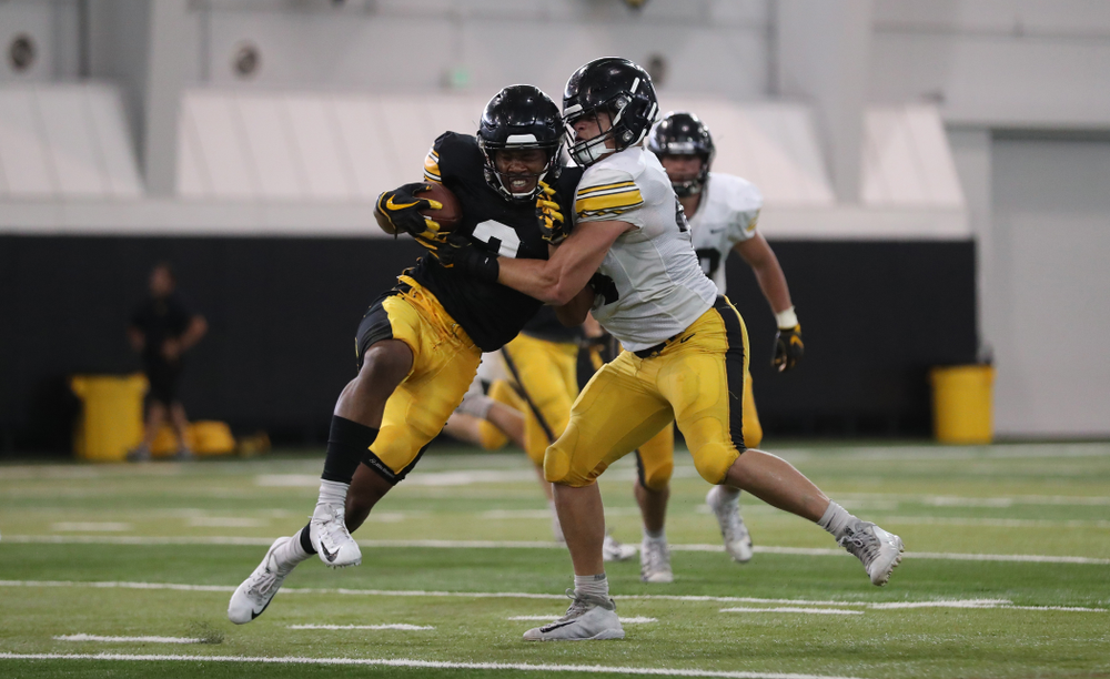 Iowa Hawkeyes wide receiver Tyrone Tracy Jr. (3) and linebacker Seth Benson (44)
