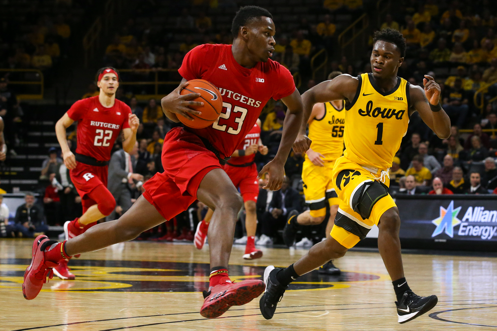 Iowa Hawkeyes guard Joe Toussaint (1) follows Rutgers guard Montez Mathis during the Iowa men's basketball game vs Rutgers on Wednesday, January 22, 2020 at Carver-Hawkeye Arena. (Lily Smith/hawkeyesports.com)