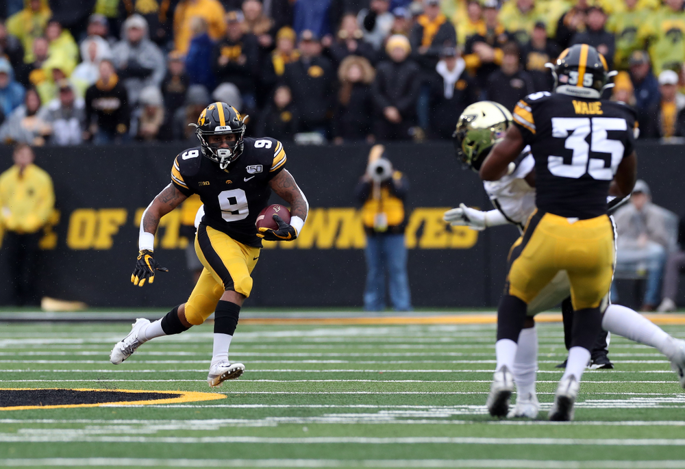 Iowa Hawkeyes defensive back Geno Stone (9) returns a punt against the Purdue Boilermakers Saturday, October 19, 2019 at Kinnick Stadium. (Brian Ray/hawkeyesports.com)