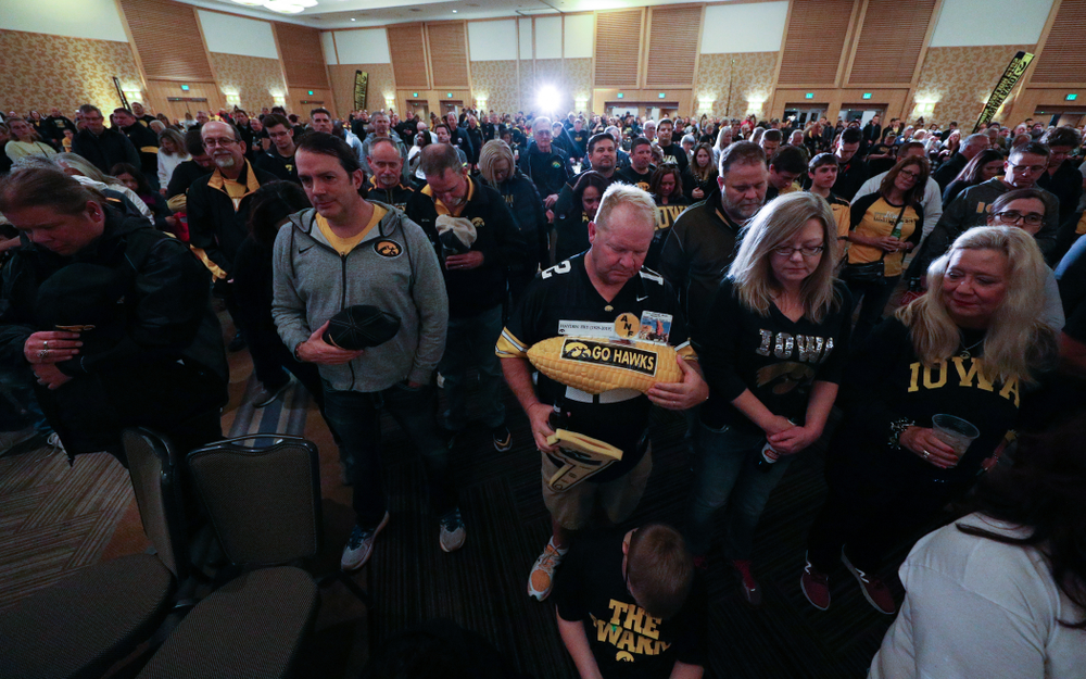 Fans pause for a moment of silence honorary Hayden Fry and Bump Elliott during the Holiday Bowl Hawkeye Huddle Thursday, December 26, 2019 at the Hilton in downtown San Diego. (Brian Ray/hawkeyesports.com)