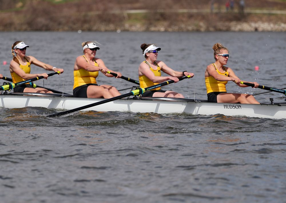 Iowa's Hunter Koenigsfeld (from left), Contessa Harold, Katie Pearson, and Eve Stewart during their 1 Varsity 8 race against Wisconsin in their Big Ten Double Dual Rowing Regatta at Lake Macbride in Solon on Saturday, Apr. 13, 2019. (Stephen Mally/hawkeyesports.com)
