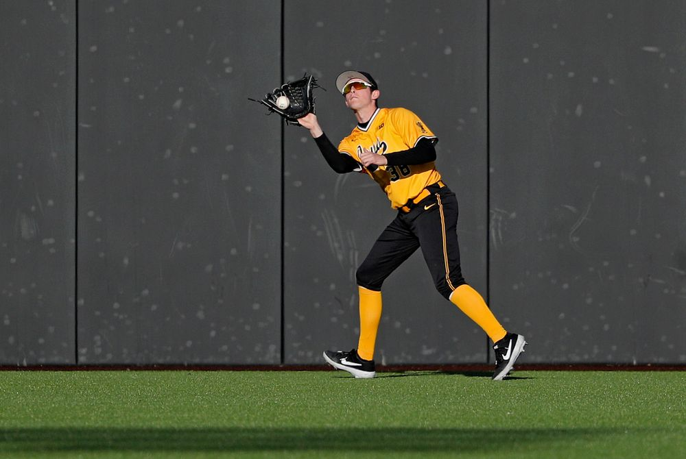 Iowa Hawkeyes right fielder Trenton Wallace (38) pulls in a fly ball for an out during the seventh inning of their game at Duane Banks Field in Iowa City on Tuesday, Apr. 2, 2019. (Stephen Mally/hawkeyesports.com)