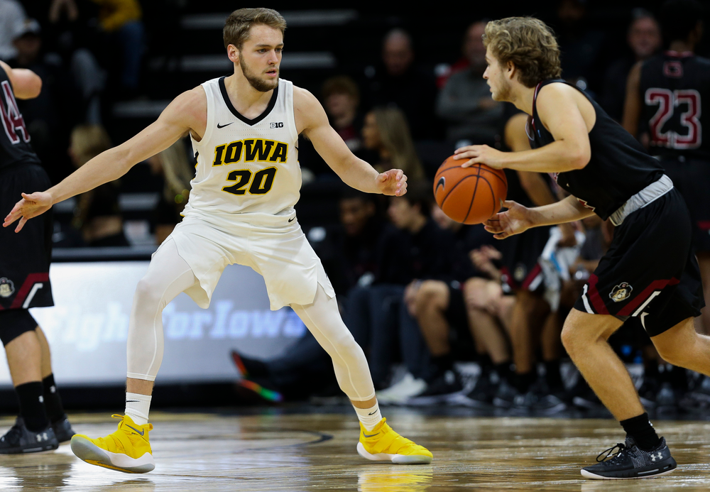 Iowa Hawkeyes forward Riley Till (20) defends during a game against Guilford College at Carver-Hawkeye Arena on November 4, 2018. (Tork Mason/hawkeyesports.com)