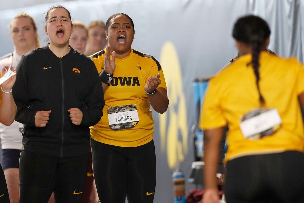 Konstadina Spanoudaki and Laulauga Tausaga applaud a throw by Nia Britt  (Darren Miller/hawkeyesports.com)