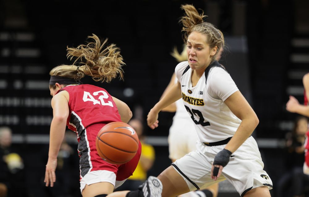 Iowa Hawkeyes guard Kathleen Doyle (22) steals the ball against the IUPUI Jaguars Saturday, December 8, 2018 at Carver-Hawkeye Arena. (Brian Ray/hawkeyesports.com)