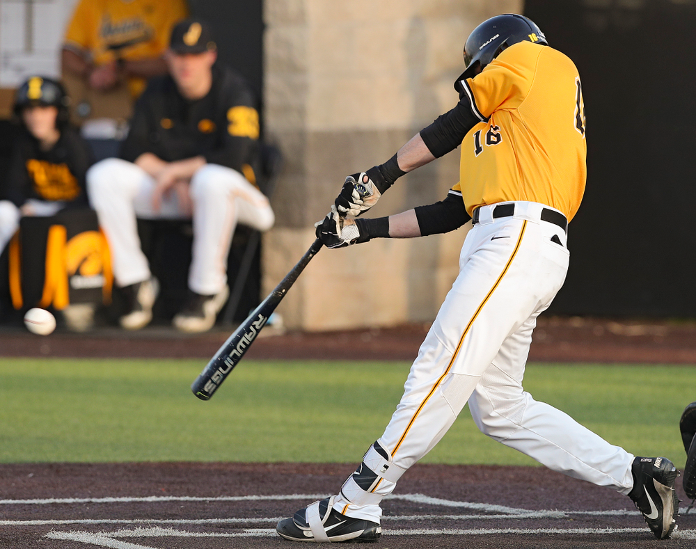 Iowa Hawkeyes shortstop Tanner Wetrich (16) hits an RBI triple during the seventh inning of their game against Northern Illinois at Duane Banks Field in Iowa City on Tuesday, Apr. 16, 2019. (Stephen Mally/hawkeyesports.com)
