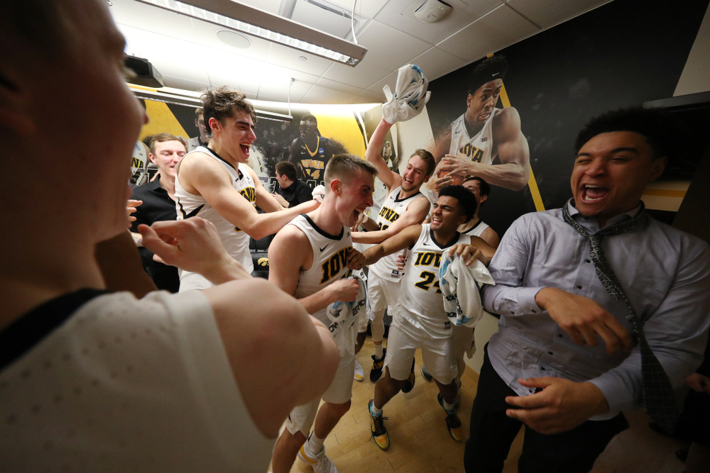 Iowa Hawkeyes guard Joe Wieskamp (10) is mobbed by his teammates in the locker after their victory over the Michigan Wolverines Friday, February 1, 2019 at Carver-Hawkeye Arena. (Brian Ray/hawkeyesports.com)