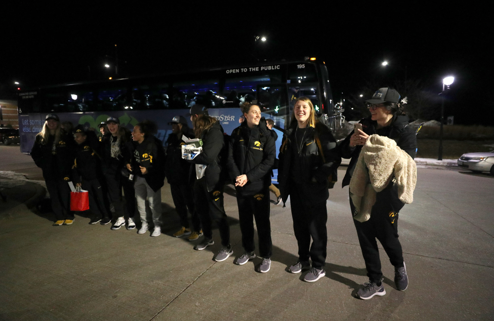 The Iowa Hawkeyes celebrates= with fans as they arrive back in Coralville after defeating the Maryland Terrapins in the Big Ten Championship Game Sunday, March 10, 2019 in Indianapolis, Ind. (Brian Ray/hawkeyesports.com)