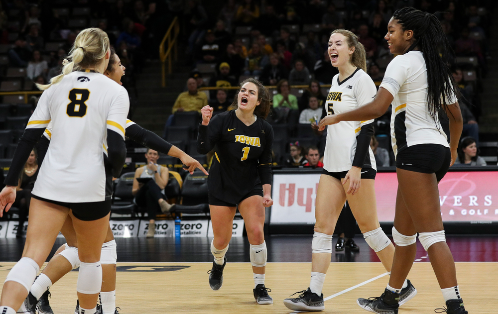 Iowa Hawkeyes defensive specialist Molly Kelly (1), Iowa Hawkeyes outside hitter Meghan Buzzerio (5) and Iowa Hawkeyes middle blocker Amiya Jones (9) celebrate after winning a point during a match against Maryland at Carver-Hawkeye Arena on November 23, 2018. (Tork Mason/hawkeyesports.com)