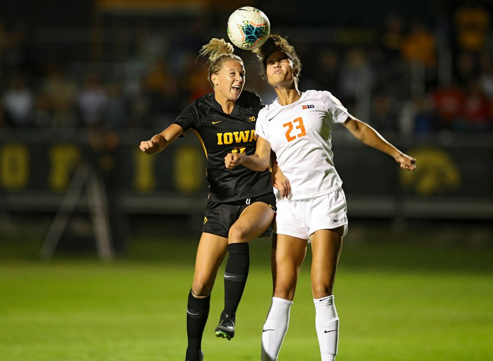 Iowa midfielder Hailey Rydberg (2) battles for a header during the second half of their match against Illinois at the Iowa Soccer Complex in Iowa City on Thursday, Sep 26, 2019. (Stephen Mally/hawkeyesports.com)