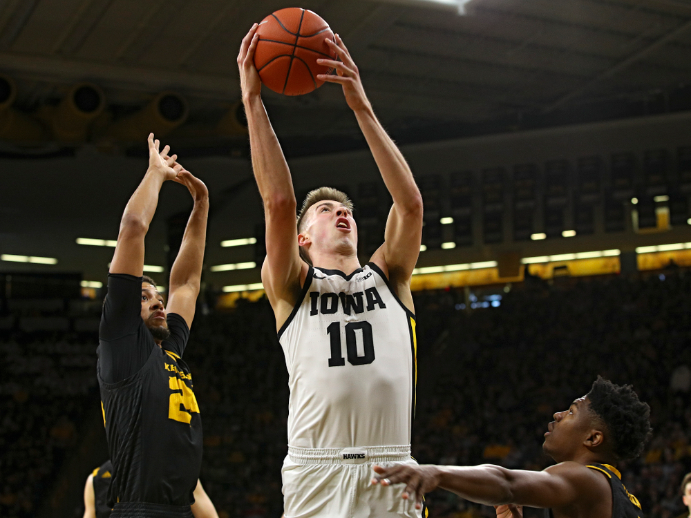 Iowa Hawkeyes guard Joe Wieskamp (10) puts up a shot during the first half of their their game at Carver-Hawkeye Arena in Iowa City on Sunday, December 29, 2019. (Stephen Mally/hawkeyesports.com)